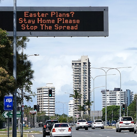 A sign warning to stay home over the Easter period is seen on approach to Surfers Paradise on the Gold Coast, Wednesday, April 8, 2020.