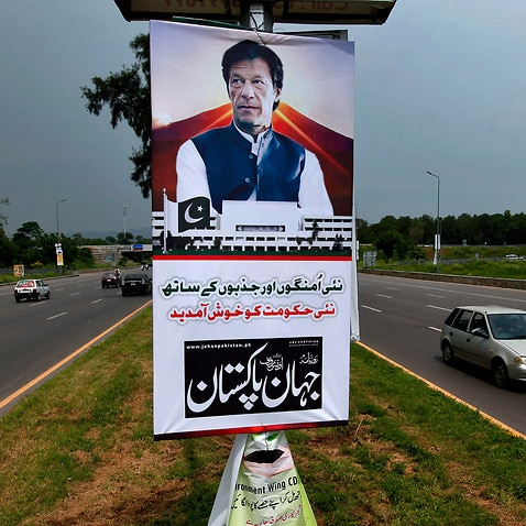 A poster congratulation Imran Khan's government displays at a highway in Islamabad.