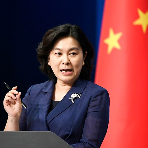 Chinese Foreign Ministry spokeswoman Hua Chunying speaks at a press conference in Beijing on July 15, 2020. (Kyodo via AP Images) ==Kyodo
