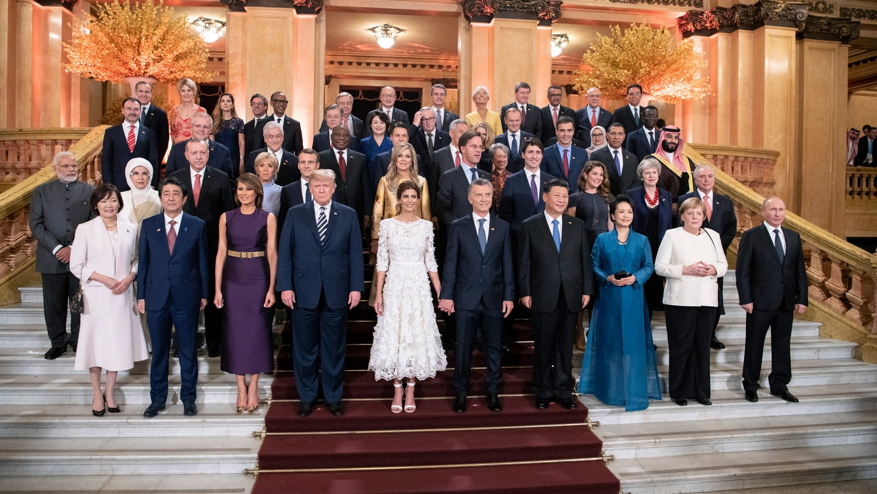 A goup picture of participating heads of states and government ending a day of the G20 Summit in Buenos Aires.
