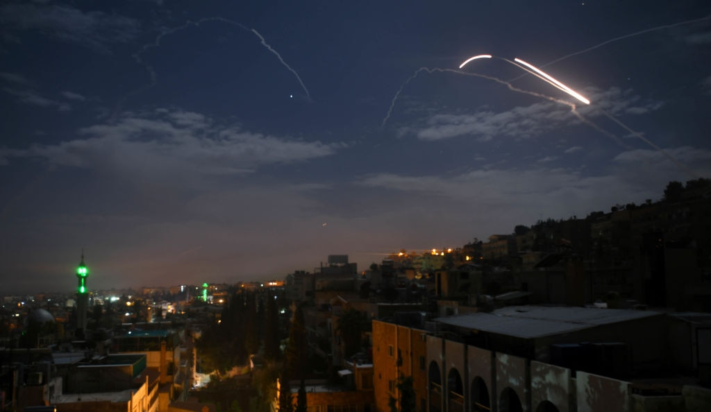 Israel struck what it said were Iranian targets in Syria in response to rocket fire it blamed on Iran, sparking concerns of an escalation.