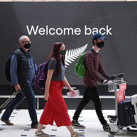 The first lot of passengers from New Zealand arrive at Sydney International Airport on Friday.