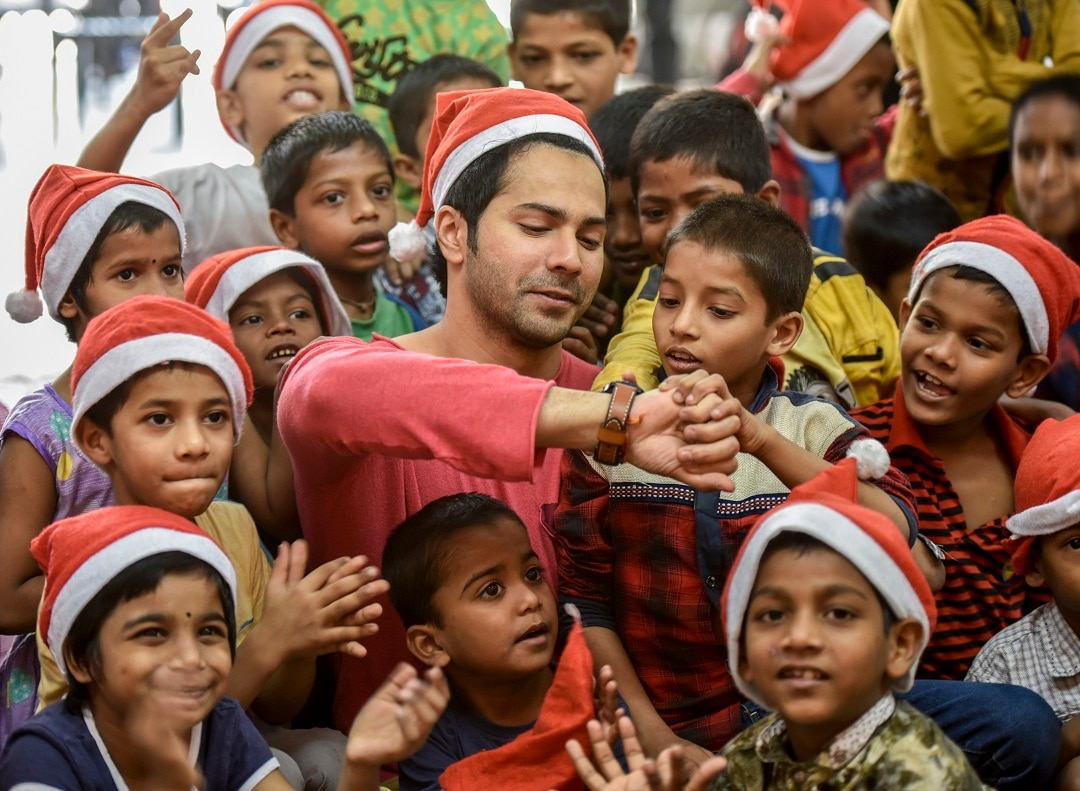 A Bollywood actor Varun Dhawan celebrates pre-Christmas Day with kids at an Indian orphanage.