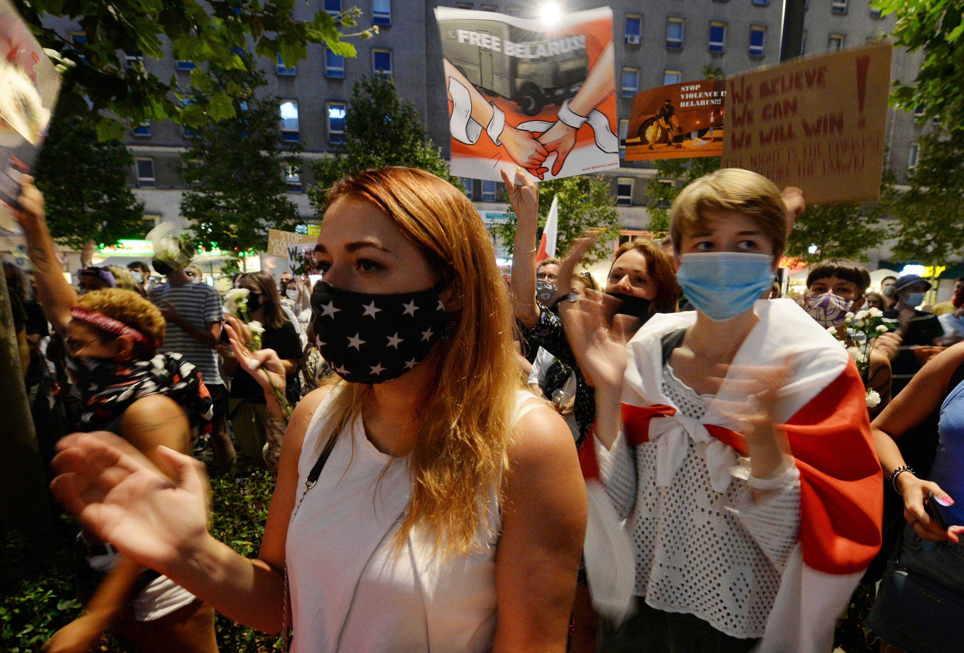 People demonstrate in support of Belarus protesters in Warsaw, Poland, on 13 August.