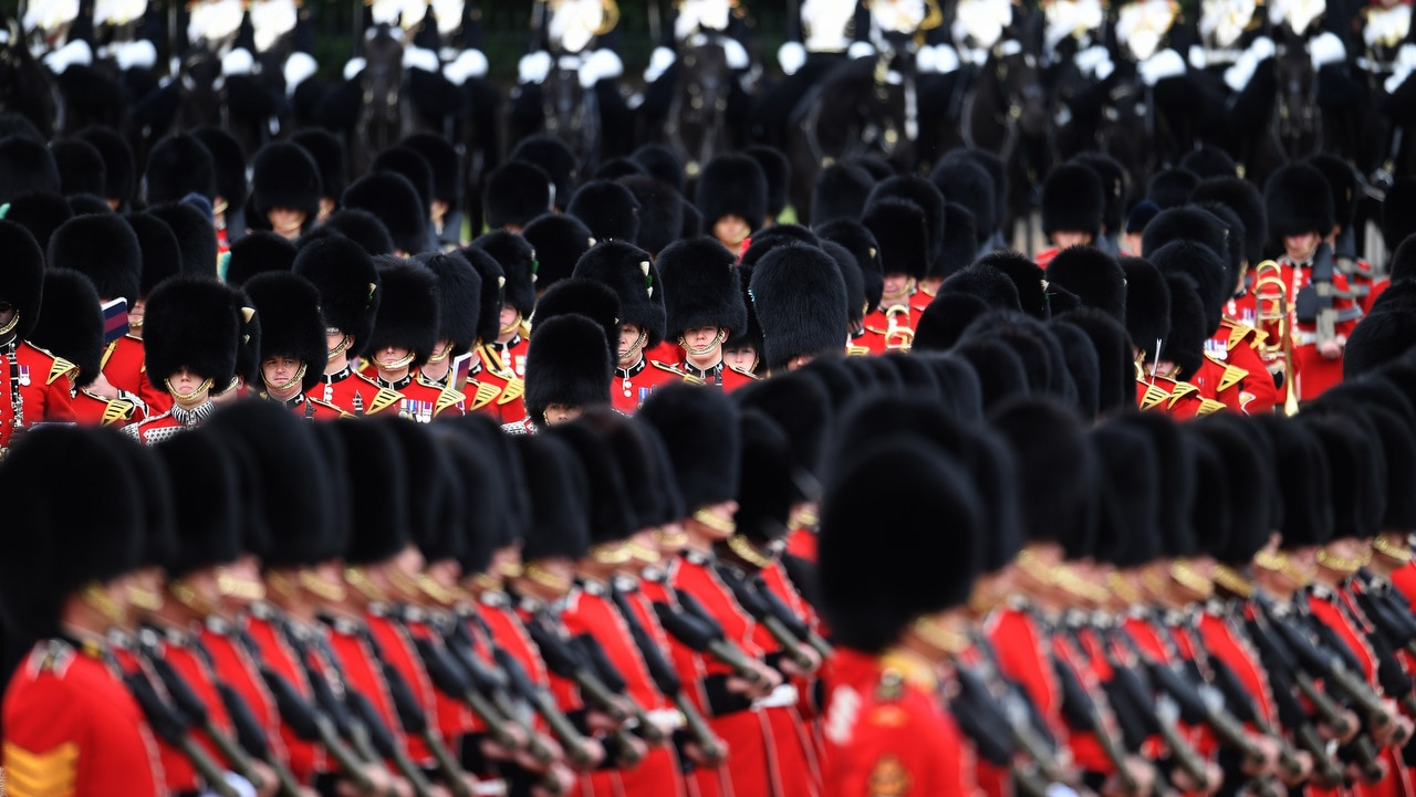 Britain's Queen's Guards march at the Horseguards Parade for the annual Trooping of the Colour in London.