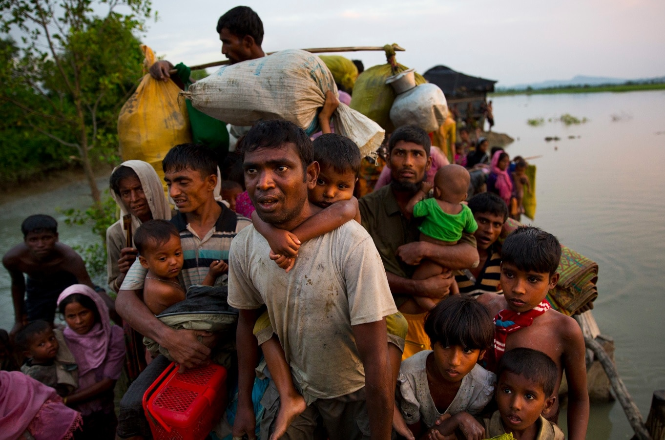 Rohingya Muslims carry their young children and belongings after crossing the border from Myanmar into Bangladesh. Some of them will be heading back.