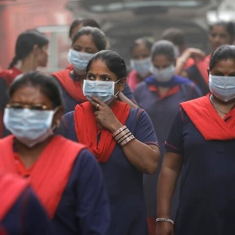 A group of Indian women wear pollution mask arrives to a protest against air pollution in New Delhi, India, Sunday, Nov. 6, 2016. Even for a city considered one of the worlds dirtiest, the Indian capital hit a new low this week. Air so dirty you can taste