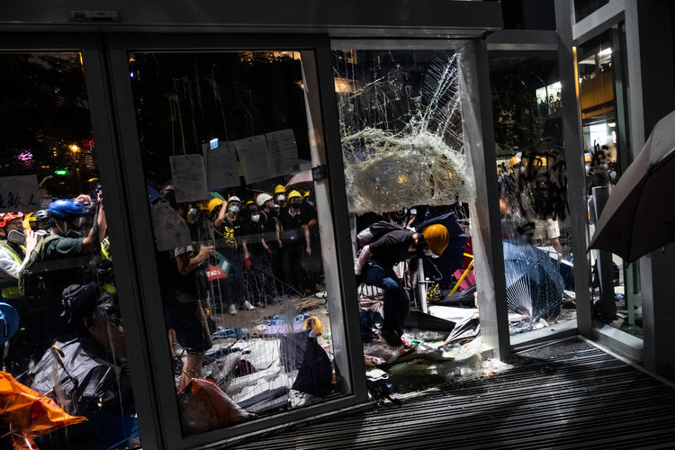 Angry Core of Hong Kong Protesters Storms Legislature, Dividing the Movement