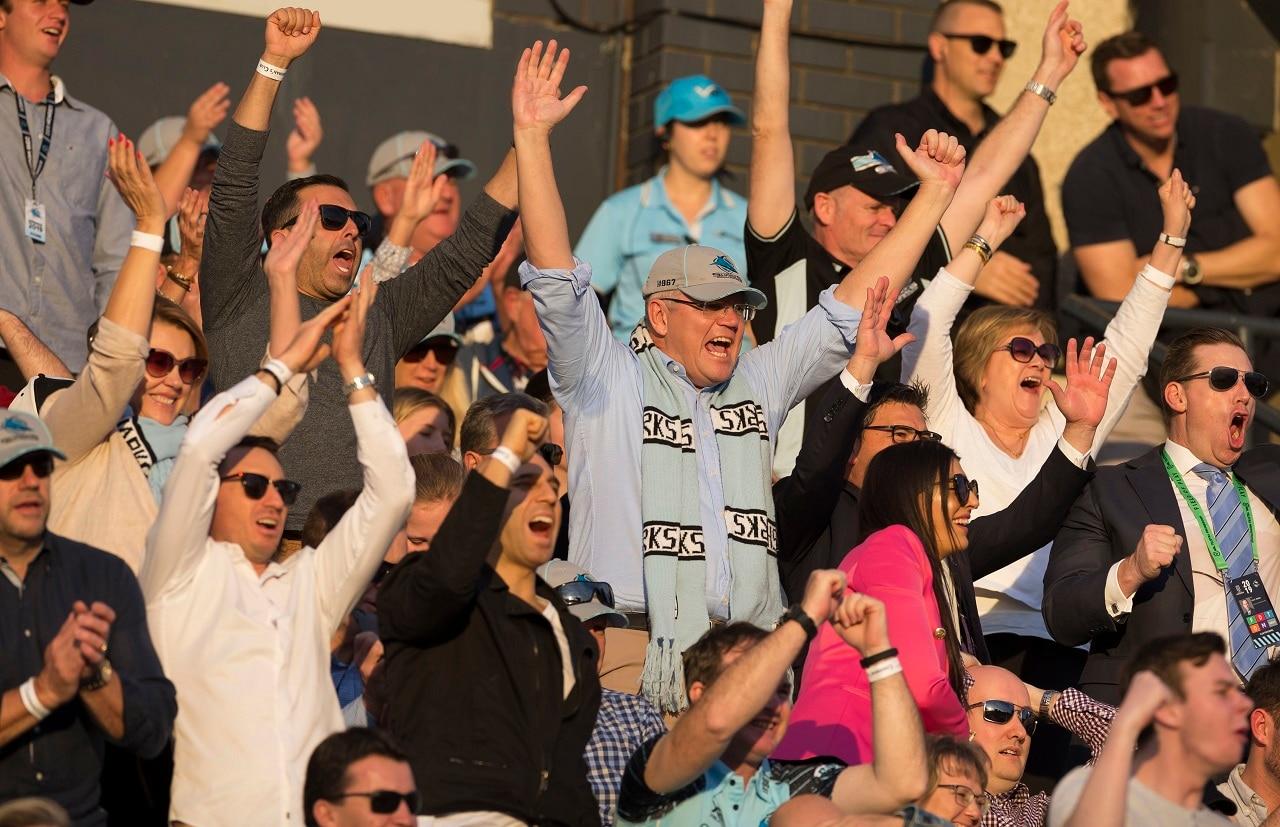 Scott Morrison celebrates at a Sharks game.