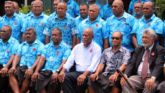 Fiji minister for employment Jone Usamate with men hired by Paladin to work on Manus in Suva.