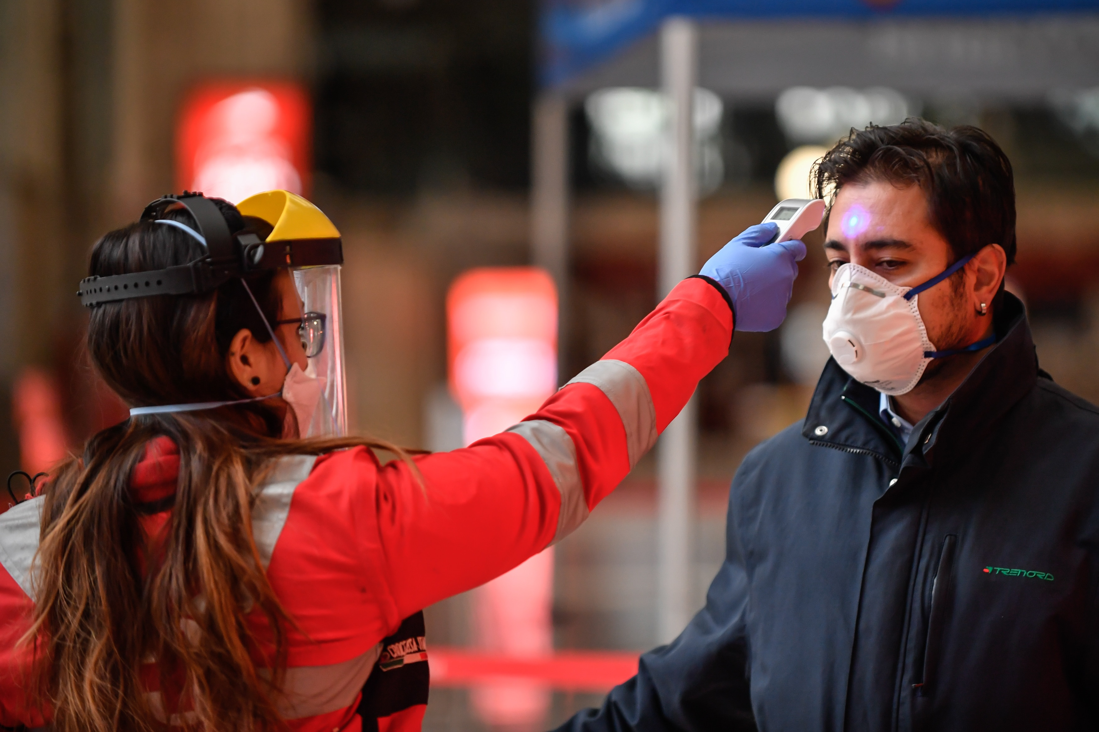 25 March 2020 Milano (Italy).Military and railway police checks at the access gates for departures in a deserted central station.In the photo: the detection of body temperature by health personnel (Photo by Claudio Furlan/LaPresse/Sipa USA)