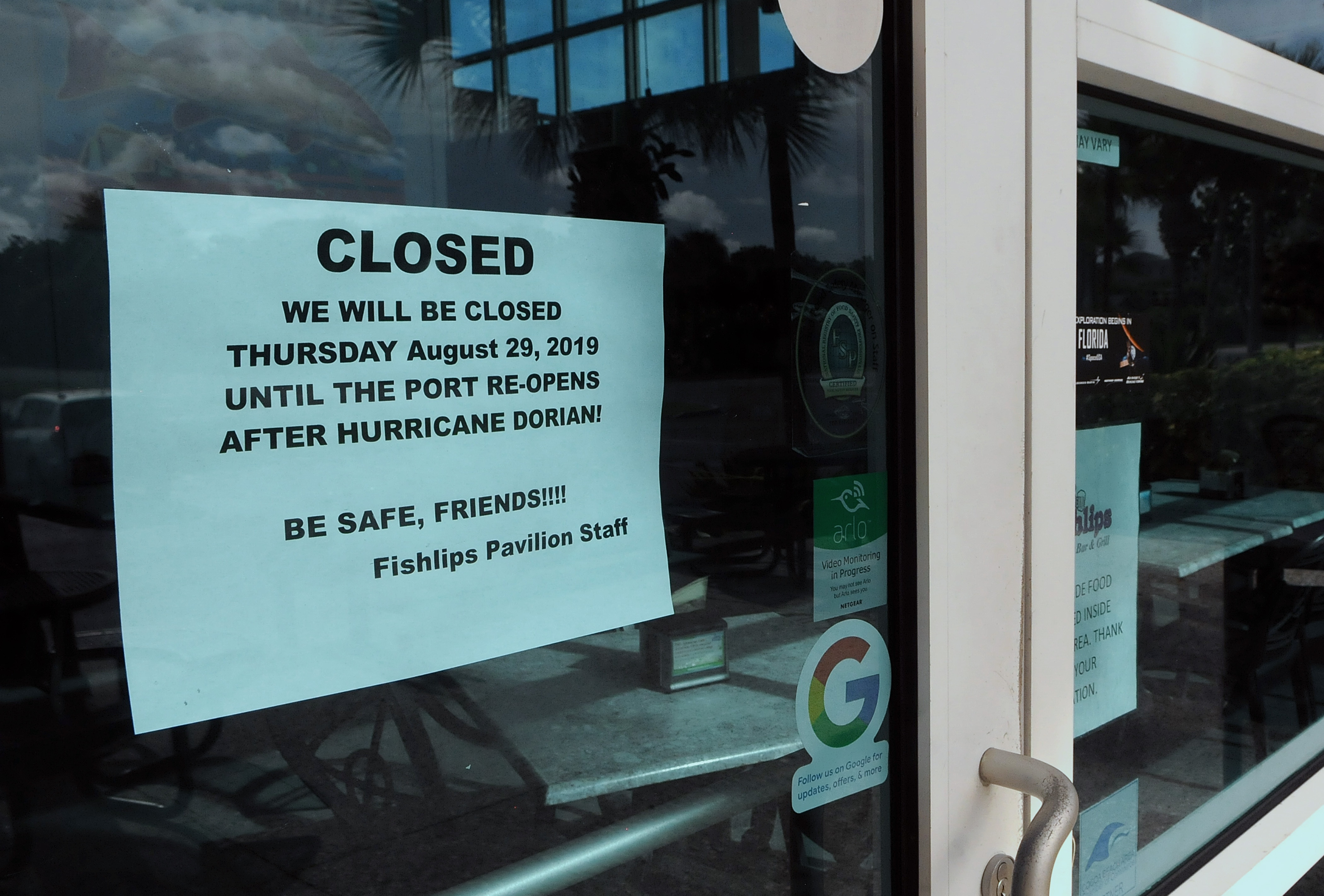 A notice is seen posted on the Fishlips Pavilion window at Jetty Park advising patrons that the restaurant will be closed due to Hurricane Dorian.