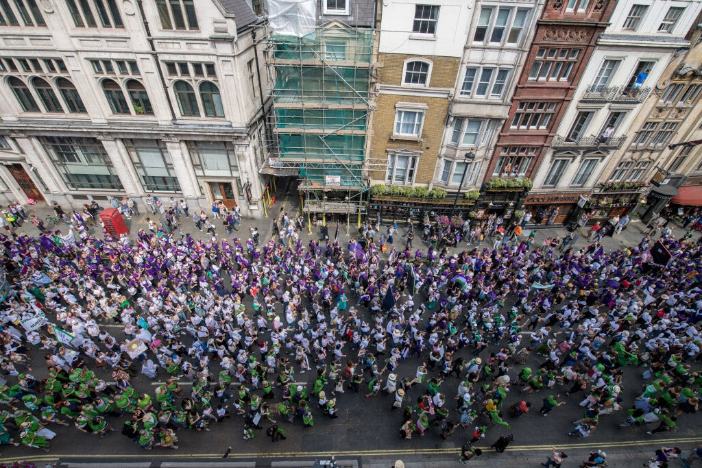 Women and girls in Belfast, Cardiff, Edinburgh and London wore either green, white or violet, the colours of the suffragette movement.