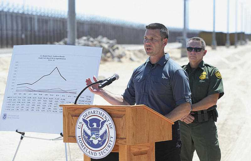 Acting Secretary of Homeland Security Kevin McAleenan, left, speaks to the media on the U.S.-Mexico border.