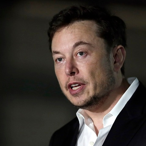 Elon Musk speaks at a news conference in Chicago.