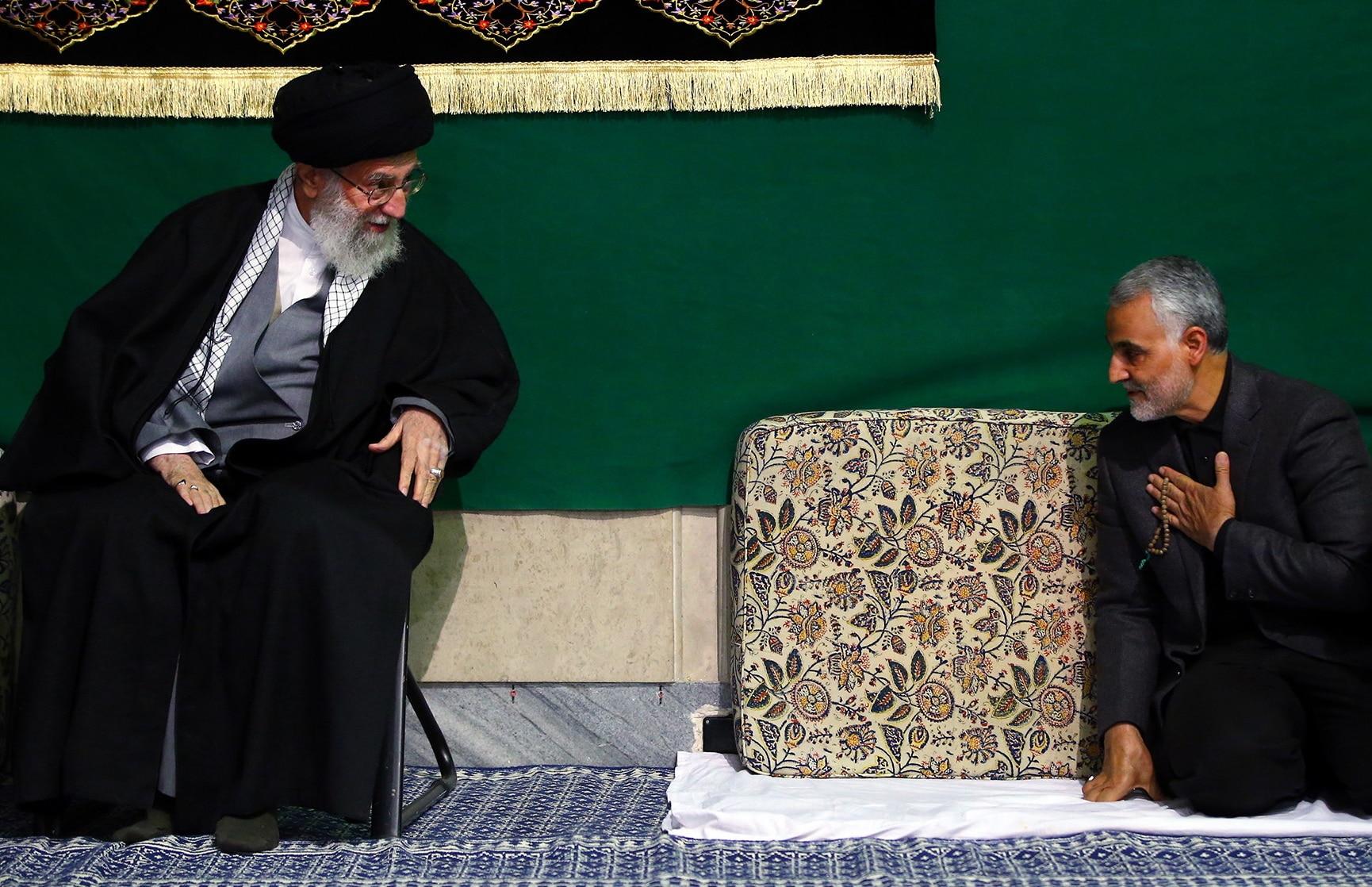 Iran's Supreme Leader Ayatollah Ali Khamenei  greets Qasem Soleimani during a religious ceremony in Tehran.