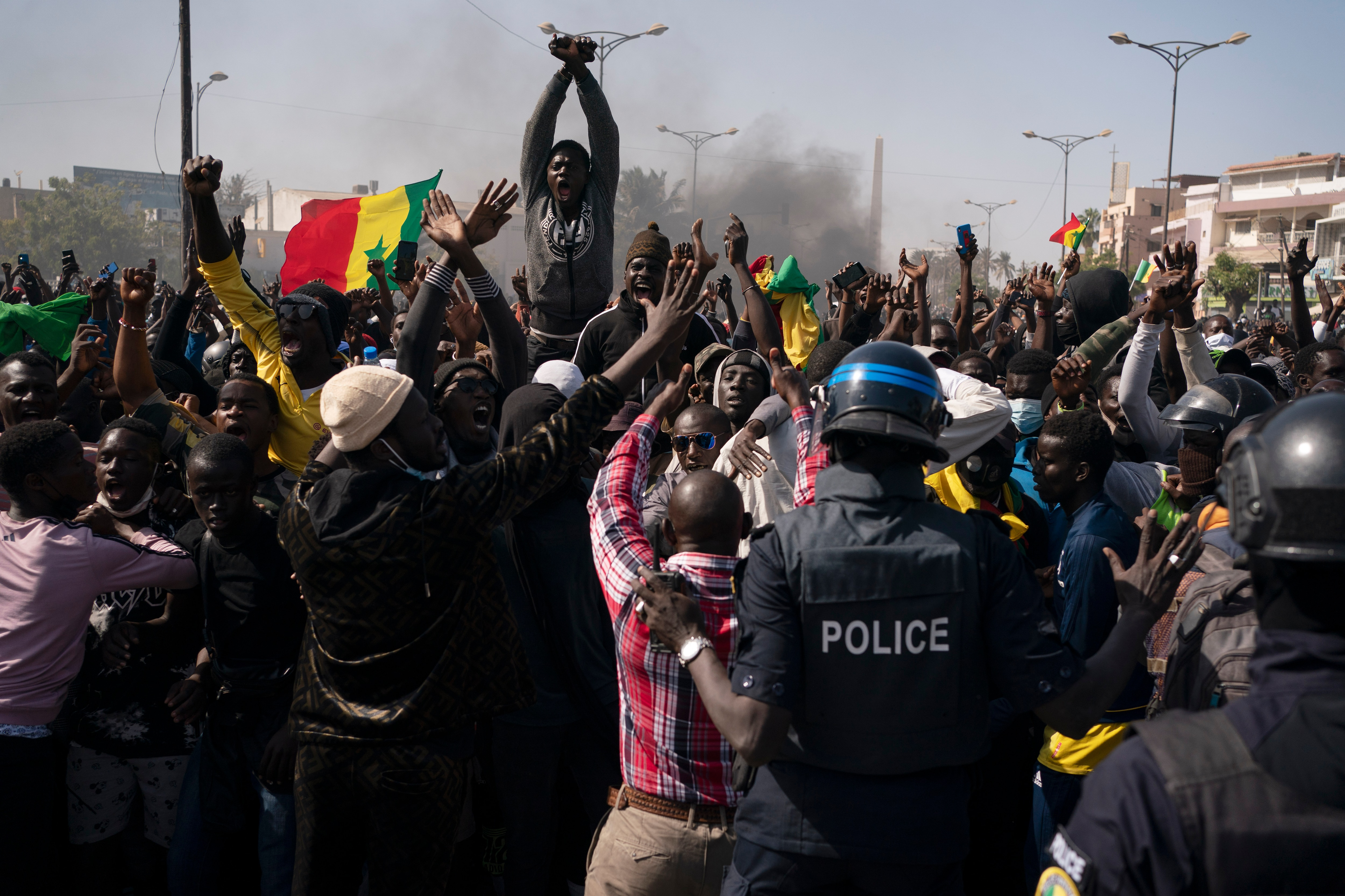 Demonstrators shout slogans in front of police during a protest against the arrest of opposition leader Ousmane Sonko, Senegal, 8 March, 2021.
