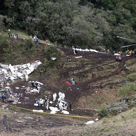 Rescue workers arrange for evacuation of the bodies of victims of an airplane that crashed in La Union, a mountainous area near Medellin, Colombia