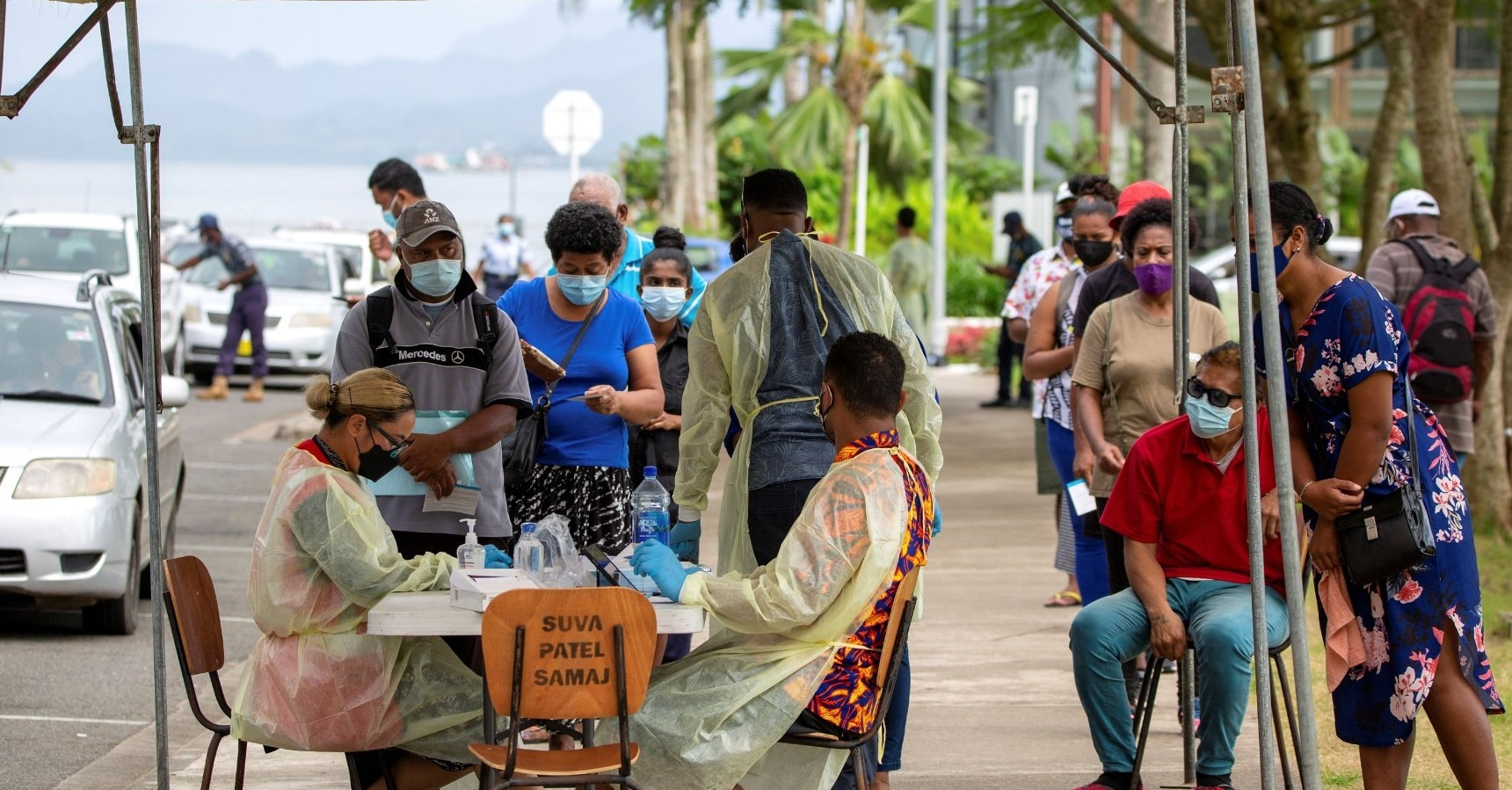 Fiji residents queue up outside a vaccination centre in Suva.