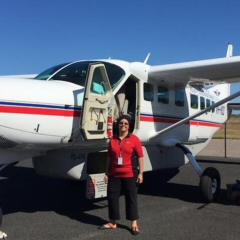 Jatinder near the RFDS aircraft that takes her from Cairs to Cape York every week