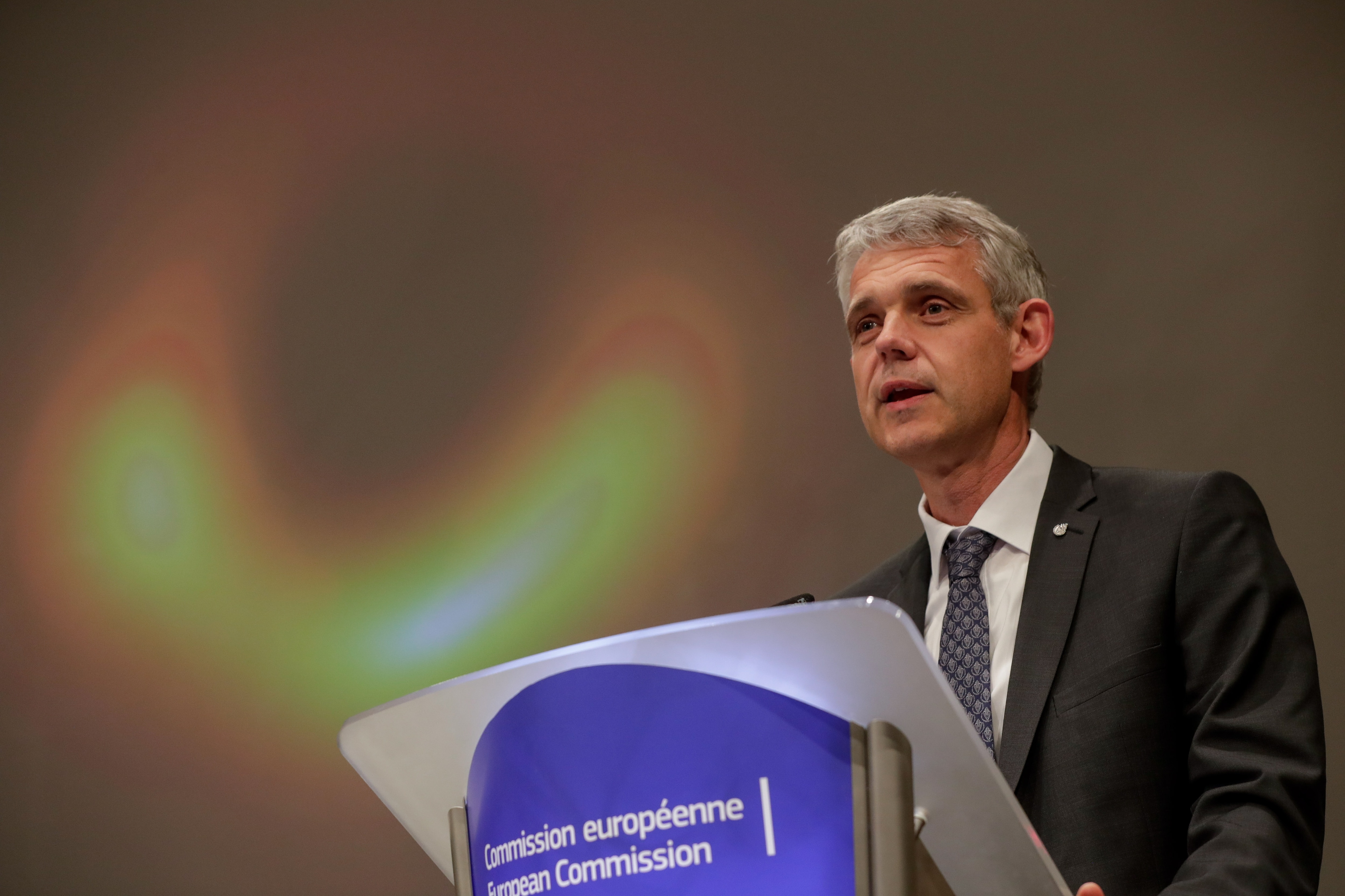 Heino Falcke, professor at the Radboud University in Nijmegen unveils the first image ever of a black hole during a press conference at the European Commission in Brussels, Belgium.