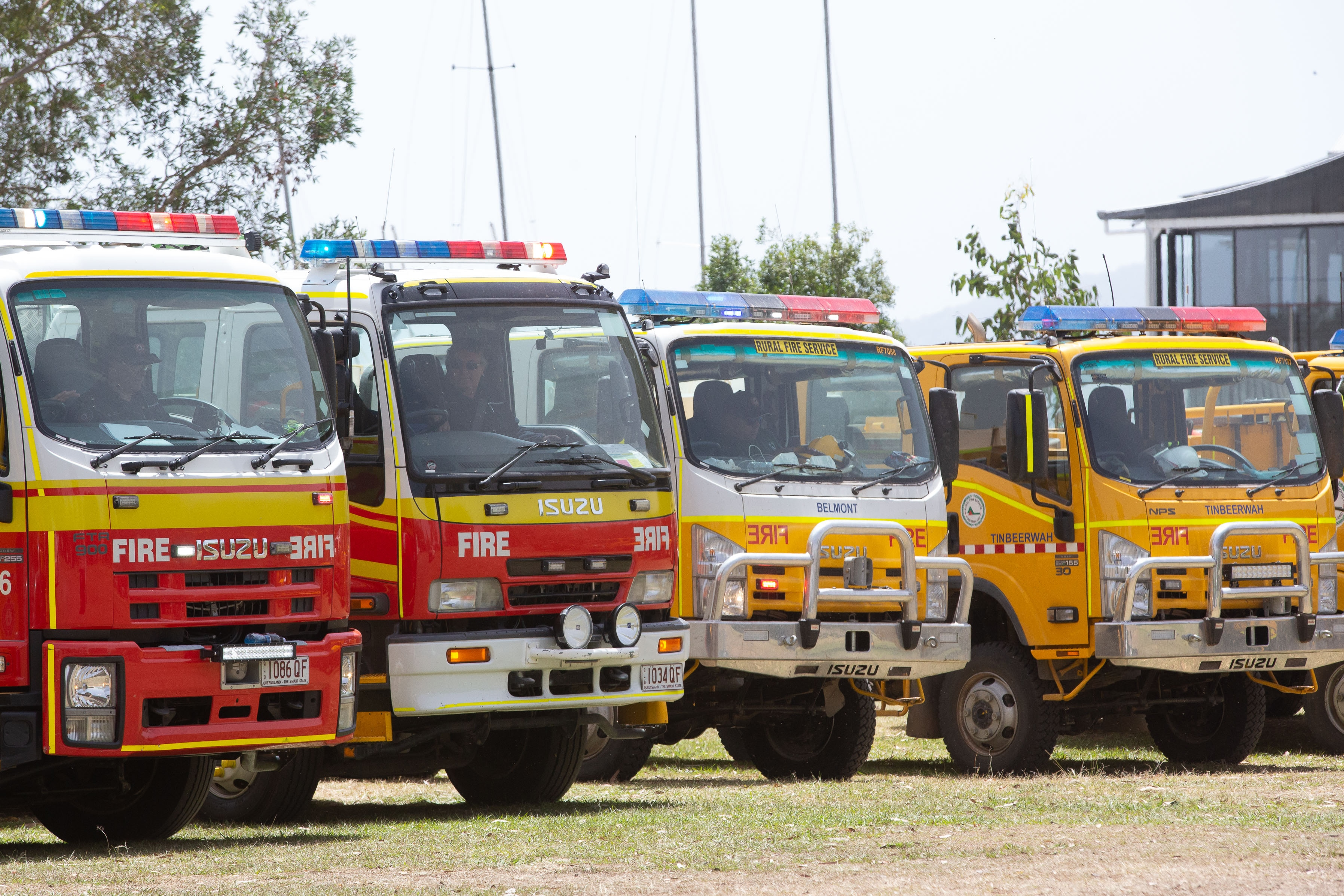 Fire trucks are seen lined up at Cooroibah in Noosa Shire, Queensland, Saturday, November 9, 2019. Thousands of residents who were evacuated from Noosa to escape the path of a bushfire are unable to go home. (AAP Image/Rob Maccoll) NO ARCHIVING