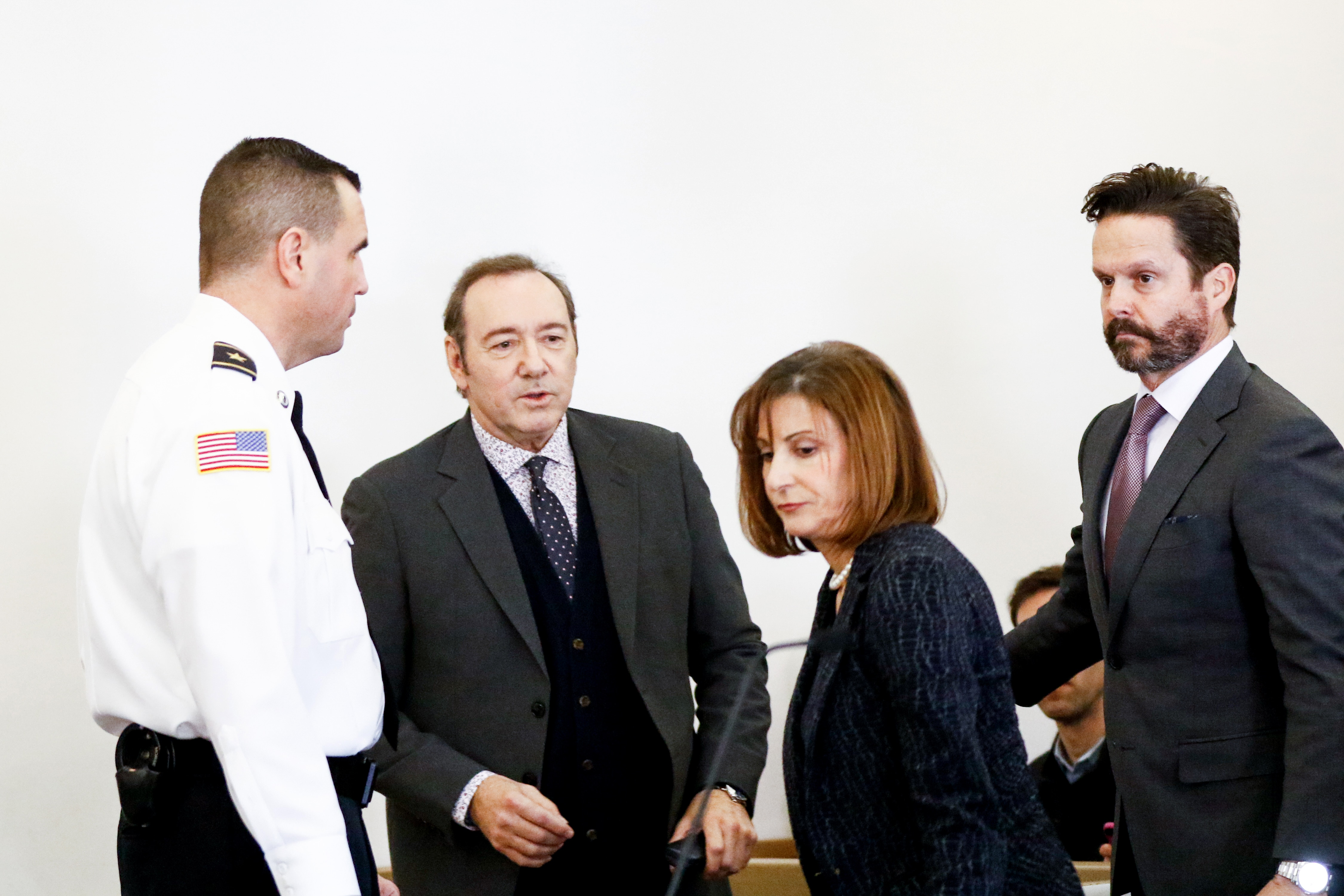 Kevin Spacey is escorted with his lawyers Juliane Baliro and Alan Jackson during his earlier arraignment for sexual assault charges at Nantucket District Court