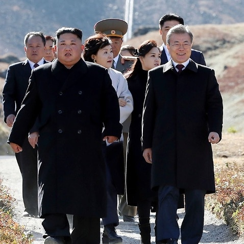 North Korean leader Kim Jong Un, center left, and South Korean President Moon Jae-in visit Mount Paektu, in North Korea, Thursday, Sept. 20, 2018.