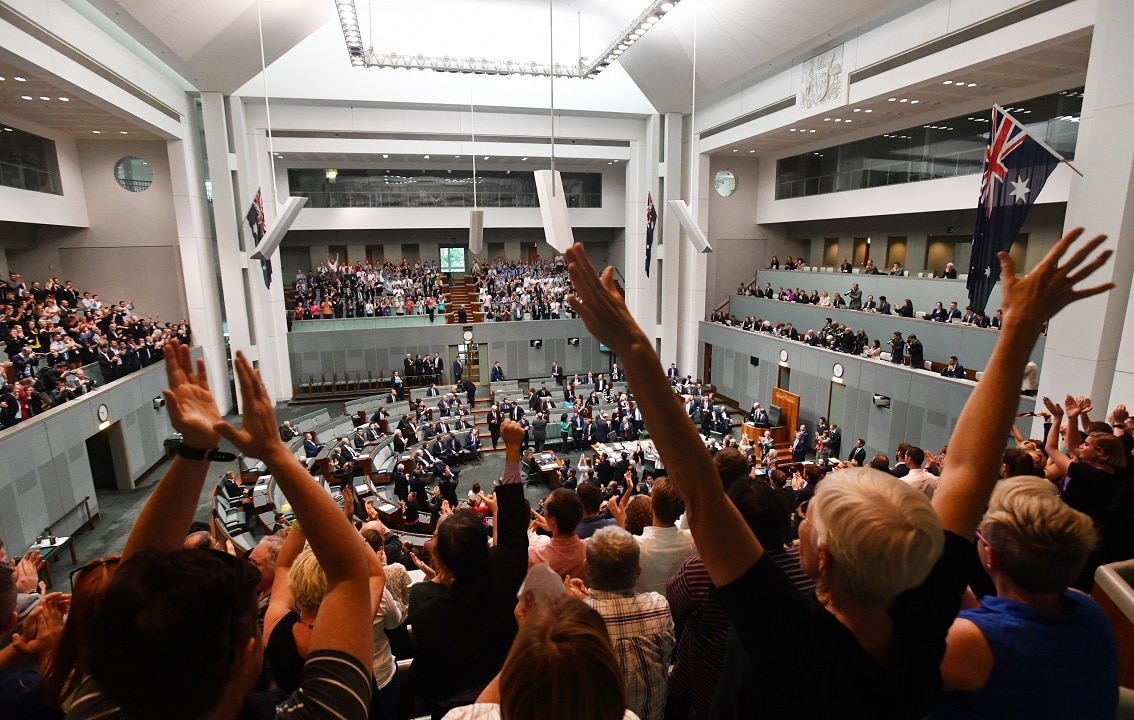 Members celebrate before the passing of the Marriage Amendment Bill in the House of Representatives at Parliament House in Canberra, Thursday, December 7, 2017. (AAP Image/Mick Tsikas) NO ARCHIVING