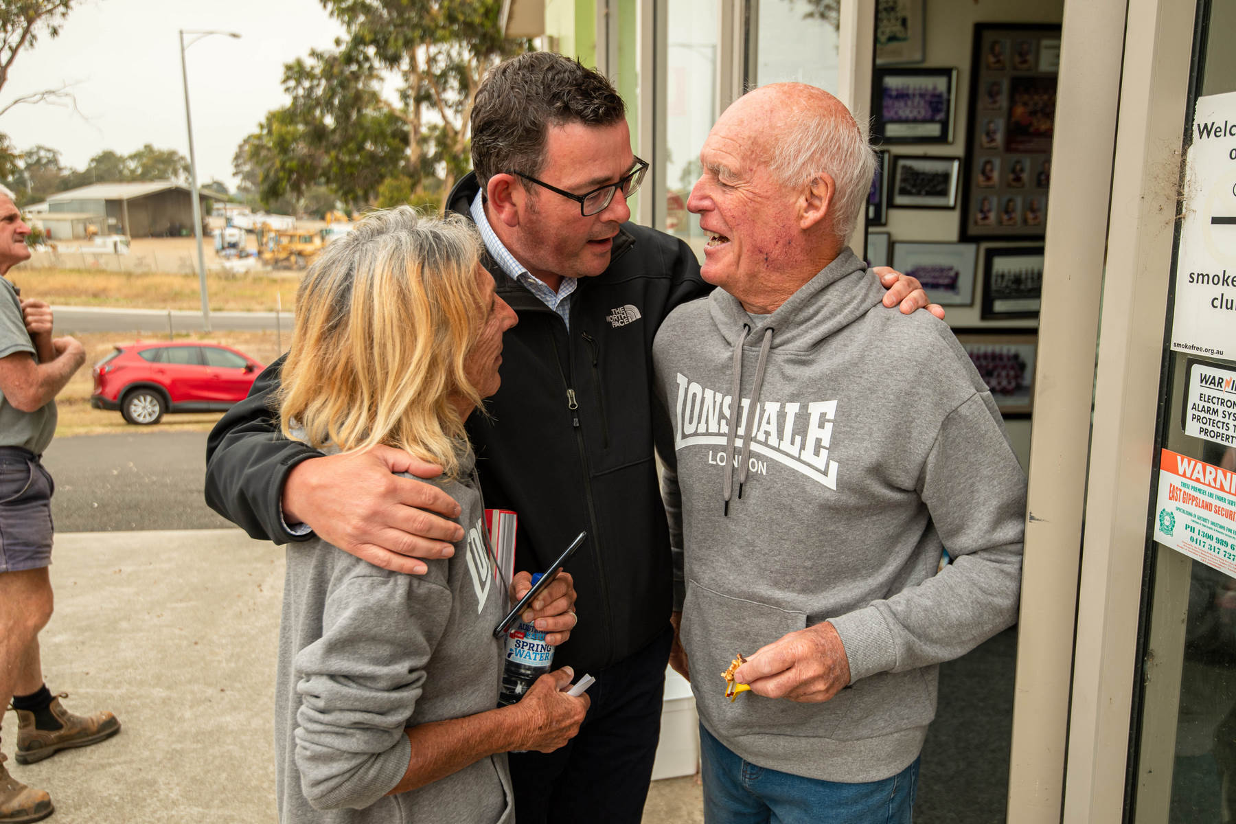 Vic Premier Daniel Andrews with a couple who lost their business in the fires in East Gippsland