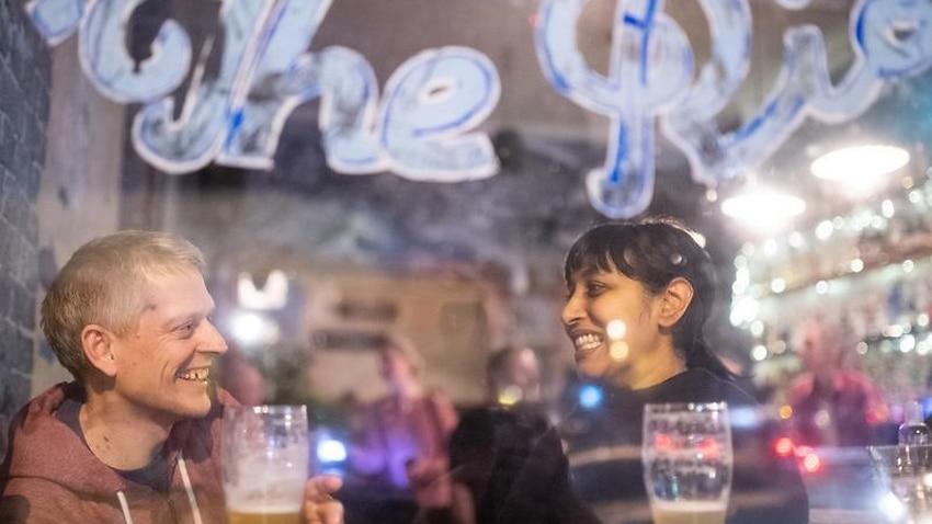 A couple enjoy drinks at a Sydney venue