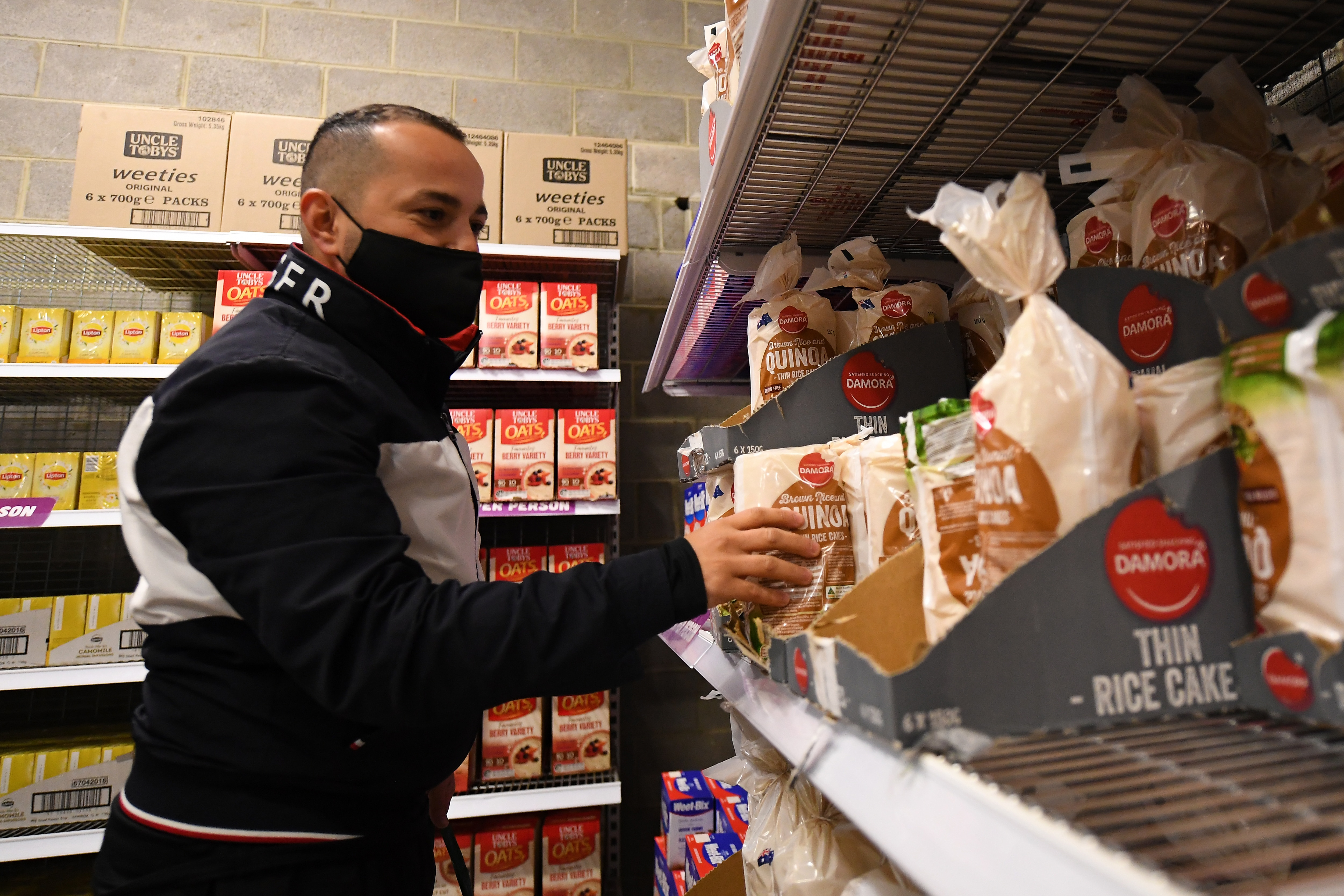 Interantional student Yasin Ilanbey collectes groceries at the Foodbank popup store in Melbourne, Friday, June 4, 2021.