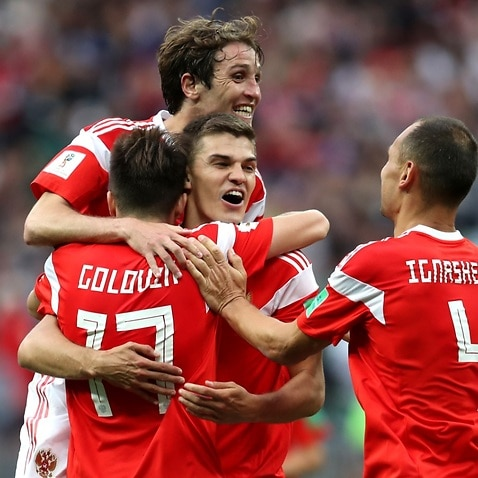 Aleksandr Golovin of Russia celebrates with team mates after scoring his team's fifth goal during the 2018 FIFA World Cup Russia