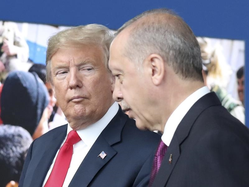 President Donald Trump has discussed a slow US pullout from Syria with Turkey's Tayyip Erdogan.