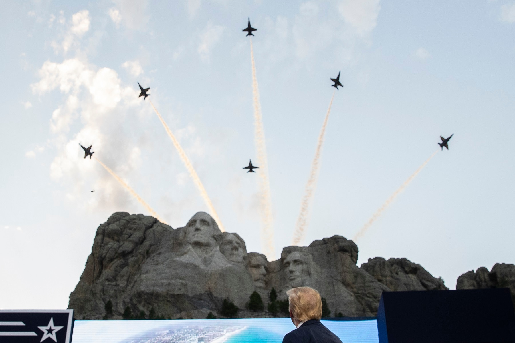 President Donald Trump watches a flyover by the US Navy Blue Angles at Mount Rushmore National Memorial.