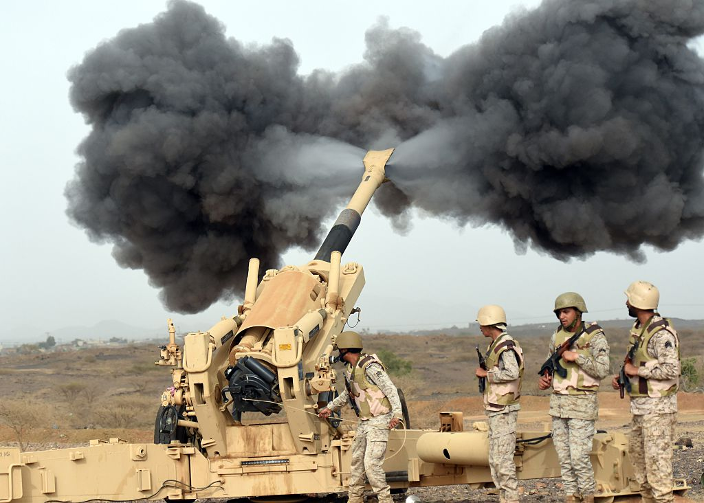 Saudi army artillery fire shells towards Yemen from a post close to the Saudi-Yemeni border.