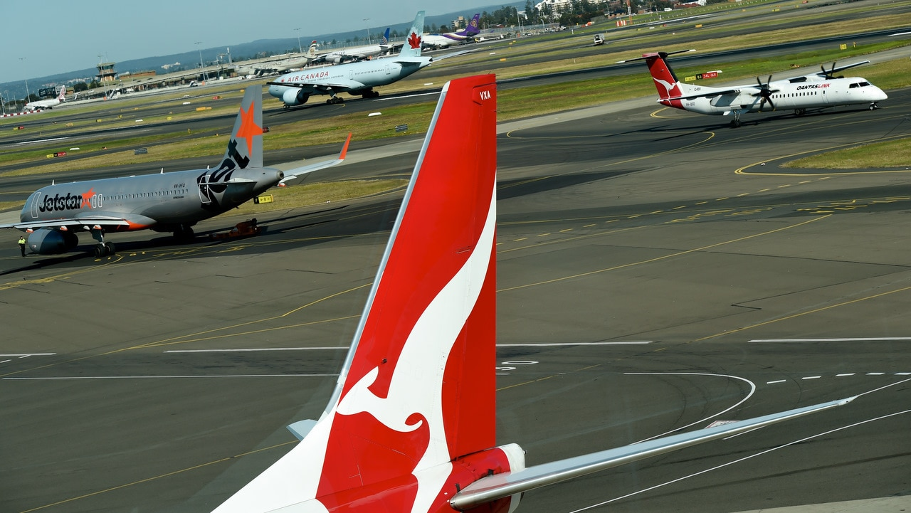 Qantas, Jetstar and an Air Canada plane on the runways at the domestic terminal in Sydney.