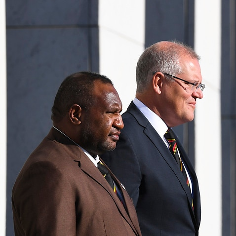 Prime Minister of Papua New Guinea James Marape and Australian Prime Minister Scott Morrison inspect the guard of honour during the official welcome ceremony.