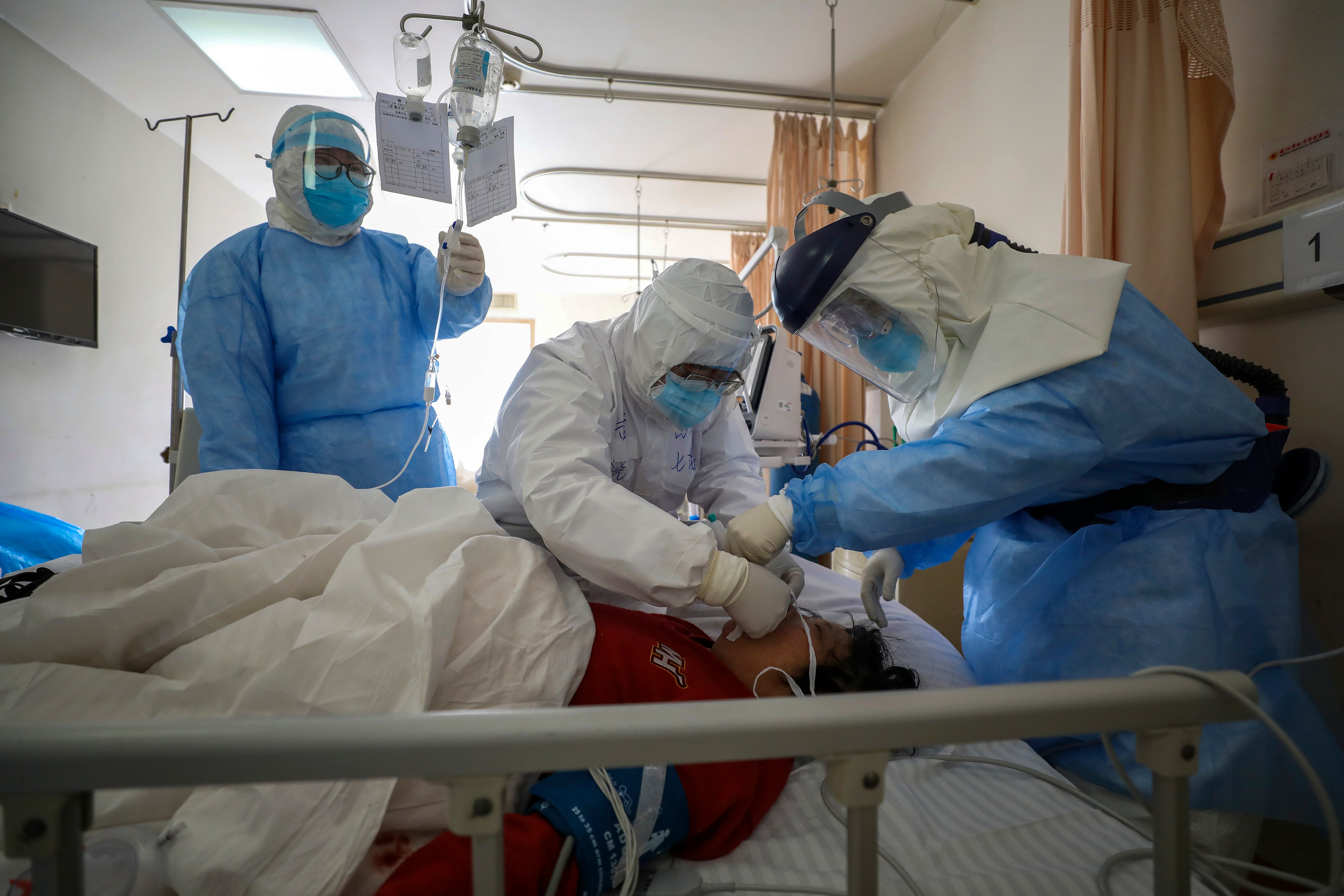 A coronavirus patient is getting treatment at a hospital in Wuhan in central China's Hubei province.