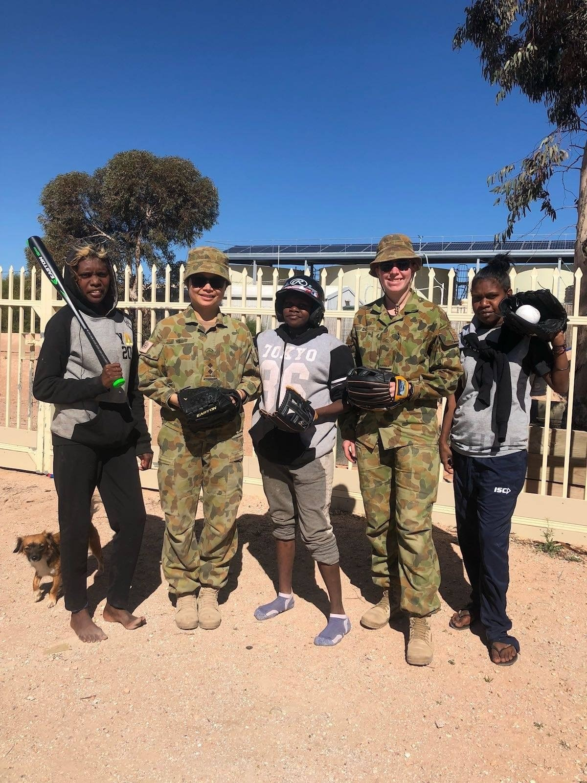 Army Aboriginal Community Assistance Program (AACAP): Australian Army Physiotherapist Captain (then Lieutenant) Xiaobei Ye (left) with local members of Yalata community in the South Australia during a community engagement, Army Aboriginal Community Assis