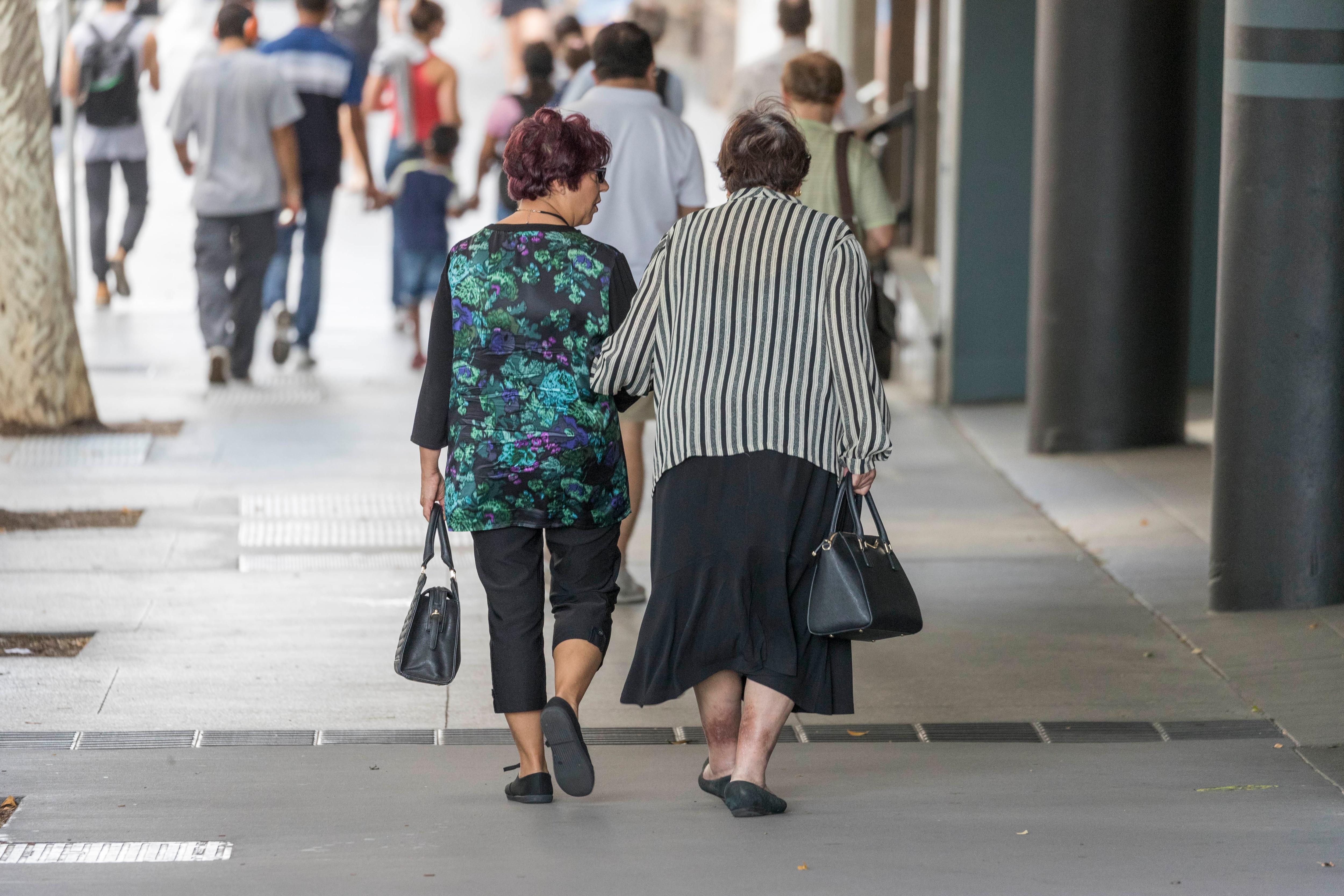 Elderly people walk in the street, in Brisbane, Saturday, May 5, 2018. (AAP Image/Glenn Hunt) NO ARCHIVING