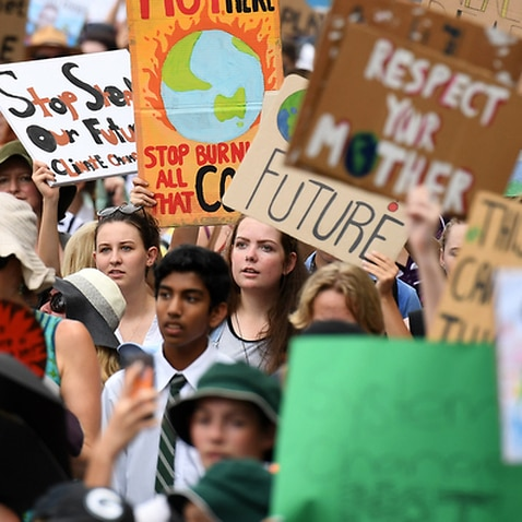 School students take part in a climate change strike in Brisbane, Friday, March 16, 2019. The strike is part of a global campaign to call for urgent action on climate change. (AAP Image/Dan Peled) NO ARCHIVING