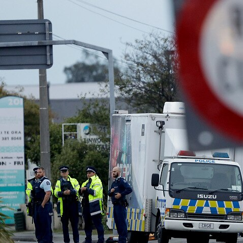 Police gather outside Linwood mosque, site of the second shooting, in central Christchurch.