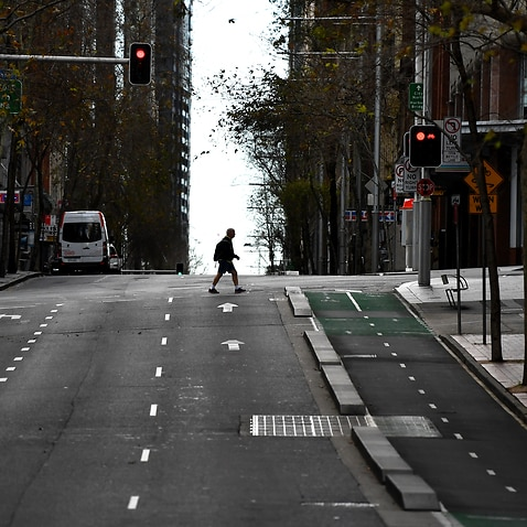 A pedestrian wearing a face mask in the central business district in Sydney Sydney, Monday, 26 July, 2021.