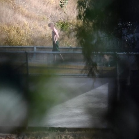 Boy on roof of Brisbane Youth Detention Centre