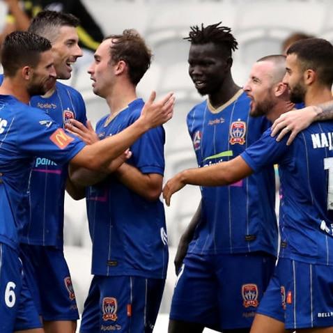 Newcastle Jets players celebrate a goal
