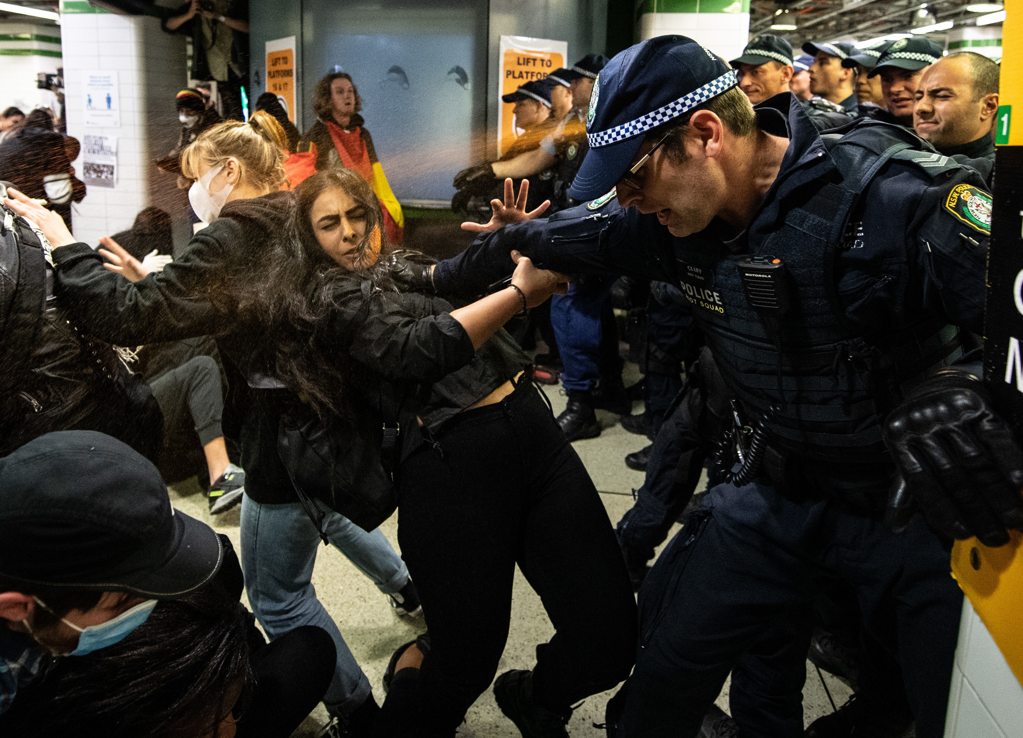 Police spray protesters with pepper spray inside Central Station after a Black Lives Matter rally in Sydney.