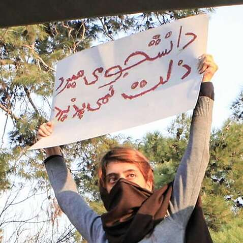 Women in Iran campaign against forced hijab laws.