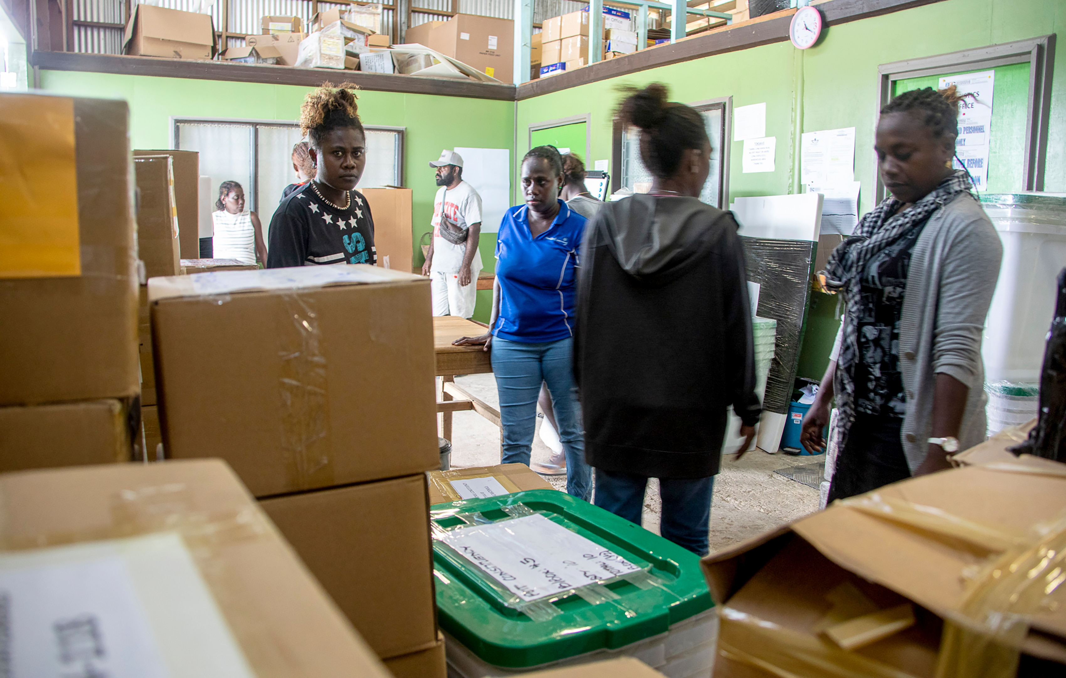 Workers prepare a polling station ahead of the historic independence vote.
