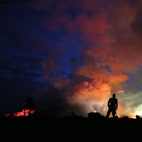 Lava from active fissures illuminates volcanic gases from the Kilauea volcano on Hawaii's Big Island.